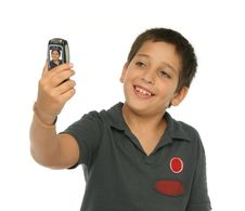Free Boy Taking A Photo With A Cell Stock Photos - 2750223