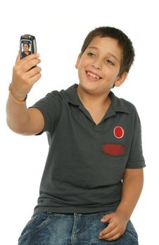 Free Boy Taking A Photo With A Cell Royalty Free Stock Photo - 2750225