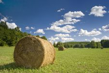 Bales Of Hay On Green Meadow Stock Photos