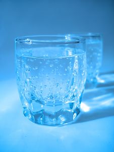 Free Glass With Water In Blue Color Stock Images - 2754334