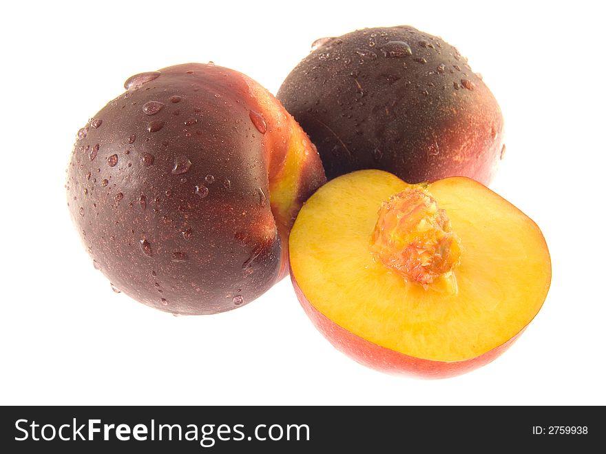 Two half ripe peaches (isolate