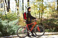 Free Man With The Bike And Sunny Autumn Day Royalty Free Stock Image - 27500476