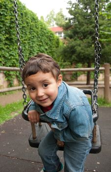 Little Cute Boy Playing On A Swing Royalty Free Stock Photos
