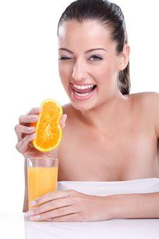 Smiling Woman Squeezes Orange Stock Photos
