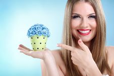 Free Girl  Holding Small Pot With Flowers Stock Photo - 27520840