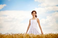 Smiling Woman In White Dress In Field Royalty Free Stock Photo