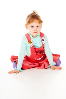 Free A Little Girl In A Red Dress, Sitting Poses Stock Photo - 27526990
