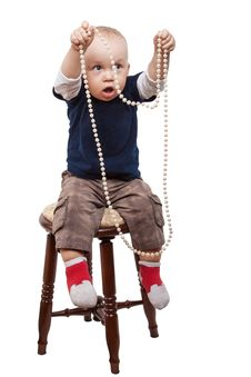 Free Boy Playing Pearl Necklace Royalty Free Stock Photos - 27529428