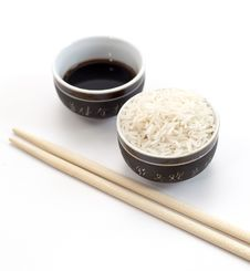 Free Uncooked Rice In A Ceramic Bow Stock Photo - 27541090