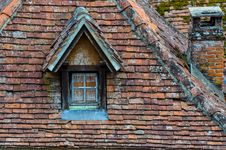 Free Old Brick Roof With Window And A Chimney Royalty Free Stock Image - 27541786