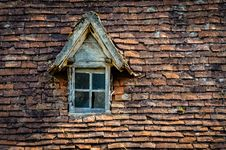 Free Old Orange Brick Roof With Broken Glass Winow Stock Photo - 27541890