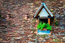 Free Old Orange Brick Roof With Window And Flowers Royalty Free Stock Photos - 27542018