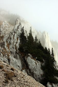 Abrupt Cliffs On The Mountain Hiding In Fog Royalty Free Stock Photo