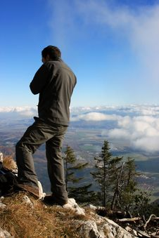 Free Man Admiring The View From The Top Of The Mountain Stock Photography - 27545962