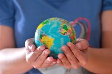 Earth Globe In Hand Royalty Free Stock Photos