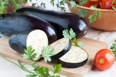 Raw Eggplant Lie On The Cutting Board Royalty Free Stock Photos