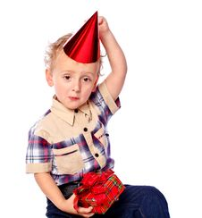 Little Boy Holding A Gift Royalty Free Stock Photos