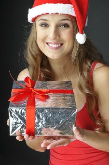 Christmas Smiling  Girl  Holds Gift Royalty Free Stock Image