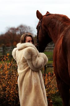 Formal Young Lady And Her Chestnut Horse Royalty Free Stock Images