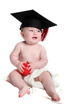 Free Emma With Graduation Hat And Red Ball Royalty Free Stock Photography - 27563587