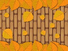 Free Autumn Leaves Over Wooden Planks Stock Image - 27566191