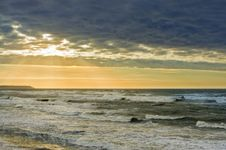 Free Sunset Over A Stormy Sea Royalty Free Stock Photo - 27578935