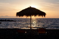 Free One Pair Of Sunchairs At Sunset Royalty Free Stock Photography - 27587237