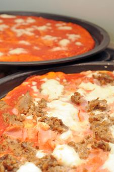 Pizza In Baking Tin Stock Image