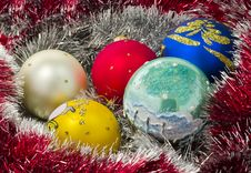 Garland And Colored Balls Over White Royalty Free Stock Image