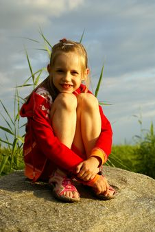Free Girl On Stoun Near Sea Royalty Free Stock Image - 2762236
