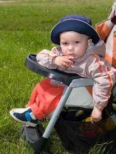 Free Amused Boy Sitting In Stroller Stock Photo - 2763310