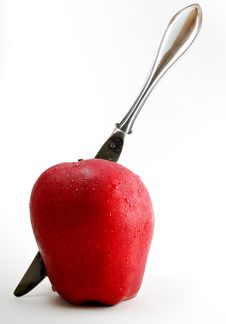 Free Sharp Knife Through An Apple Stock Photos - 2769763