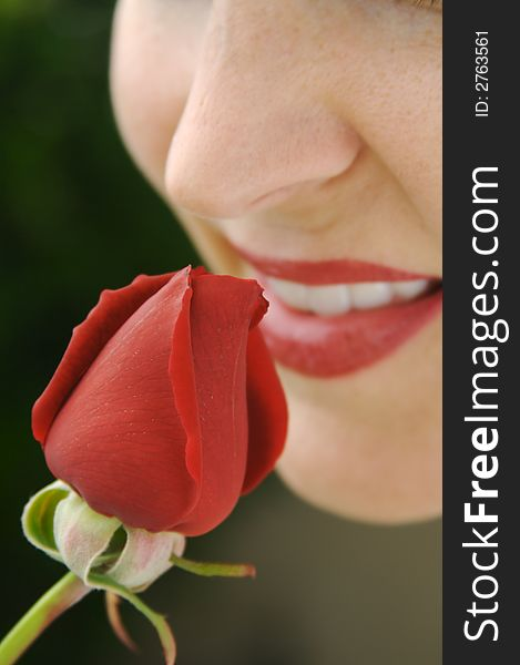 Woman Smelling Rose Bud