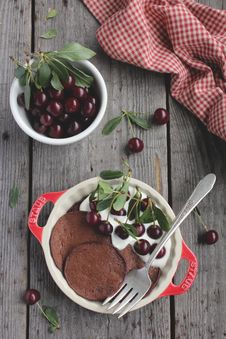 Chocolate Pancakes With Fresh Cherries Royalty Free Stock Photos
