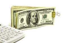 Free US Dollar And Calculator Stock Image - 27606531