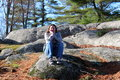 Free Pretty Brunette Sitting On Rocks In Woods Stock Images - 27619064