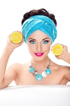 Free Smiling Woman Holding Fresh Lemon - Wholesome Food Royalty Free Stock Photo - 27611515