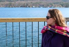 Free Young Woman Dressed Warmly,sitting On Dock Royalty Free Stock Photography - 27619037