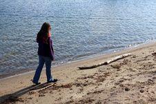 Free Brunette Woman Walking Along Empty Beach Royalty Free Stock Photo - 27619335