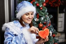 Free Happy Woman With Christmas Costume Receives Gift Royalty Free Stock Image - 27620556