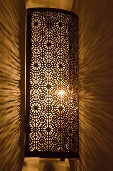 Free Ornate Metal Lamp Glowing On Marble Wall Royalty Free Stock Image - 27627576