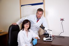 Free Scientists Coworkers Near By Microscope Royalty Free Stock Photos - 27630968