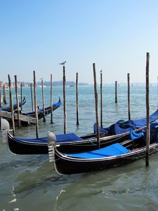Free Gondolas Parked On A Venetian Water Canal Royalty Free Stock Image - 27633236