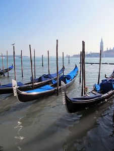 Free Gondolas Parked On A Venetian Water Canal Stock Photography - 27633382