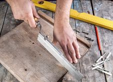 Free Carpenter Working On A Hand Saw Stock Photo - 27634280