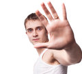 Free Young Man Looking Out From Under Raised Hand Royalty Free Stock Photography - 27641377