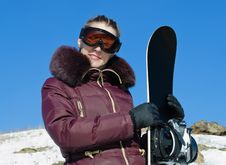 The Young Woman With A Snowboard Royalty Free Stock Image