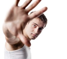 Free Young Man Looking Out From Under Raised Hand Royalty Free Stock Image - 27641576