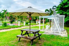 Free Chairs And Umbrella At The Garden Royalty Free Stock Image - 27642896