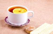 Tea With Lemon And Sweet Treats Stock Images